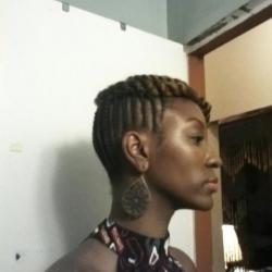 Chic updo for black hair at Sabines Hallway Natural Hair Salon & Spa in Brooklyn, NY.