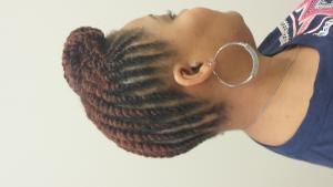 Braided updo for black hair at Posh Hair Designz in Laurel, MD.