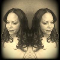 This soft curled finsh was achieved  by silk press and ceramic iron barrel curls