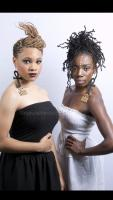 Two-strand twists (extensions) with comb twists (black dress) and loc extensions (white dress)  at Naturalcentric Hair Salon in Largo, MD.