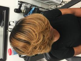 Layered Feathered Haircut and Style in Alexandris,La