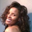 Long wavy style for black hair by Ahseek Salon in Allen, Texas.